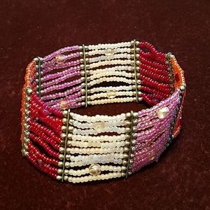 Stretch bracelet. Shades of pink and silver.